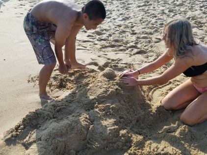 Nobody was too old to still have fun burying their brother in the sand